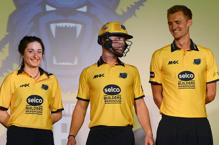 Cricket players in yellow Birmingham bear shirts