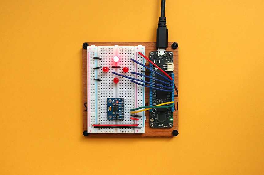 Circuit board on a flat orange background
