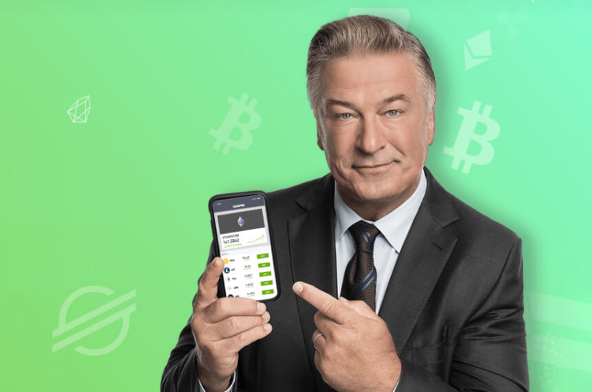 man pointing at phone with a trading app