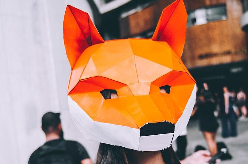 A lady wearing a fox mask