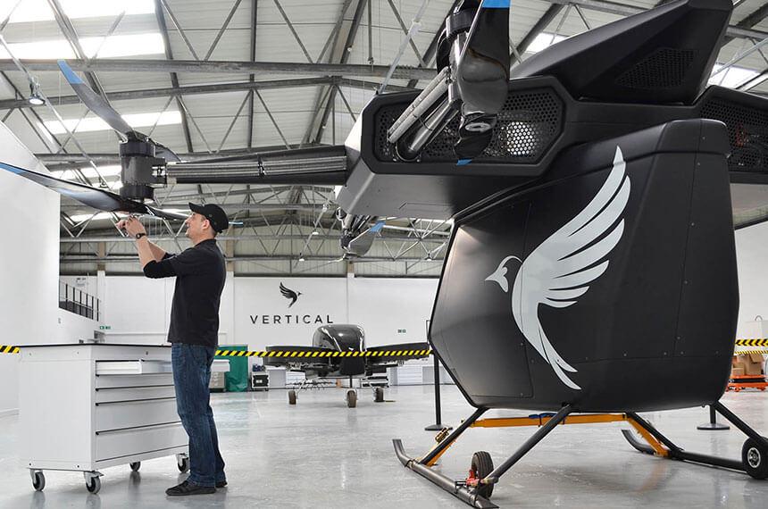 Huge drone with man tweaking the propeller blade