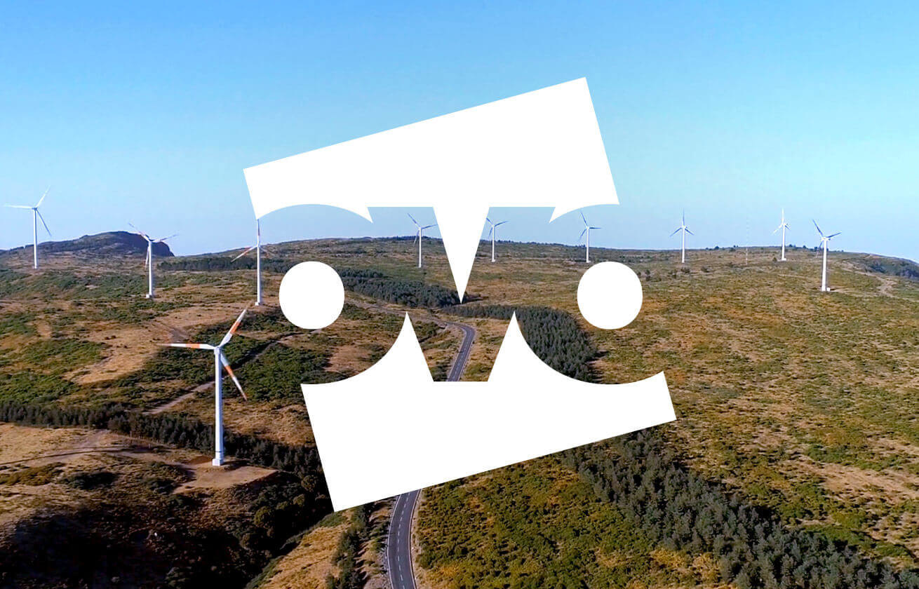 Beautiful landscape with wind turbines and Ovo logo on top of them