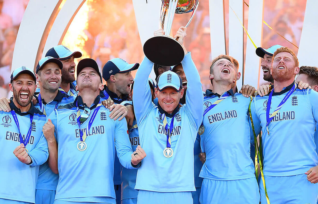 England cricket team holding a big trophy above their heads