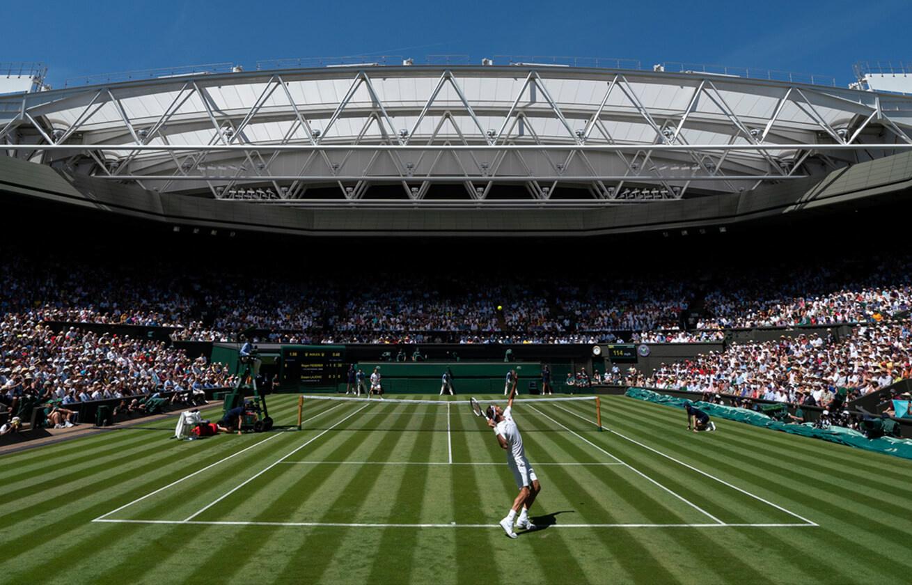 Wimbledon Tennis match, man about to swing Tennis racket