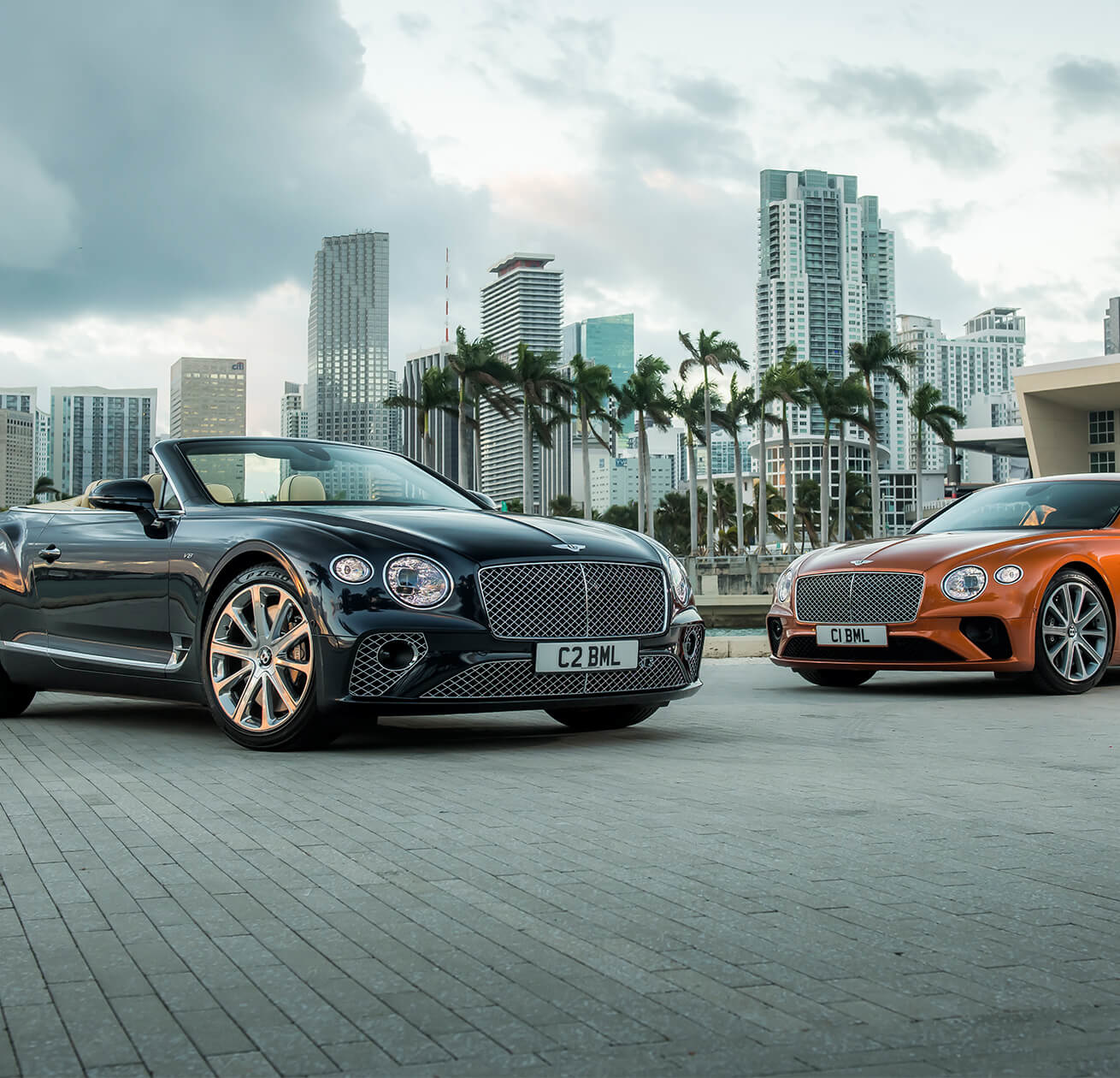 2 Bentleys infront of a city scape