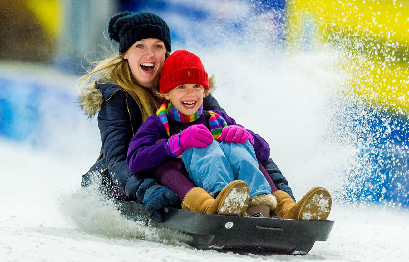 Mom and daughter sledging