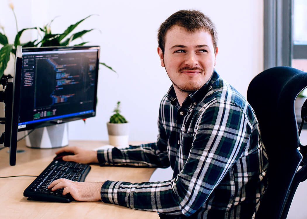 Sam, from Class Digital Agency, looking over his shoulder giving a cheeky smirk