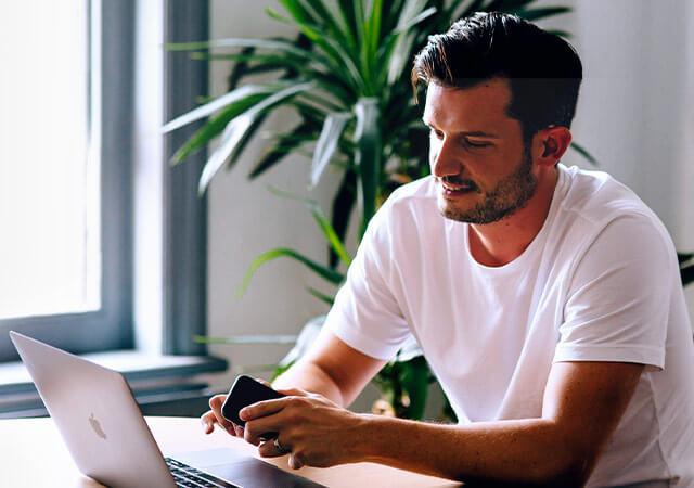 Chris Pyatt from Class reviewing a website design on his laptop